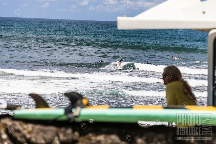 Surfers at Honoli'i Beach Park and Bay, Hilo, Big Island.