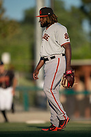 San Jose Giants relief pitcher Rodolfo Martinez (40) walks towards his catcher after a California League game against the Modesto Nuts at John Thurman Field on May 9, 2018 in Modesto, California. San Jose defeated Modesto 9-5. (Zachary Lucy/Four Seam Images)