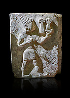 Hittite orthostat relief depicting a god. Hittie Period 1450 - 1200 BC. Hattusa Boğazkale. Hattusa Boğazkale. Çorum Archaeological Museum, Corum, Turkey. Çorum Archaeological Museum, Corum, Turkey. Against a black bacground.