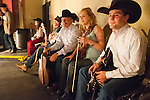 25th Annual National Cowboy Poetry Gathering sponsored by the Western Folklife Center, Elko, Nev...Silver Jubilee show at the Elko Convention Center Auditorium..Waddie Mitchell ready to enter the stage as the Burson Family watches from the side
