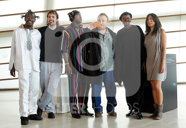 Spanish director Isaki Lacuesta (2nd L) poses with actors Alou Cisse (L) of Mali, Amon Pegnere Dolo (3rd L), Amassagou Dolo (2nd R), Spanish artist Miquel Barcelo (3rd L) and writer Isa Campo (R) during the 59th San Sebastian Donostia International Film Festival - Zinemaldia.September 19,2011.(ALTERPHOTOS/ALFAQUI/Acero)