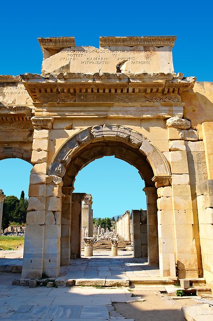 The Mazeus Mithridates Gate to the Agora of Ephesus takes its name from the 2 Freed slave of  Emperor Augustus who paid for its contruction. It is dedicated to Emperor Augustus, his wife Livia , his daughter Julia and her husband Agrippa. Built in 4 or 3 B.C. Ephesus Archaeological Site, Anatolia, Turkey.