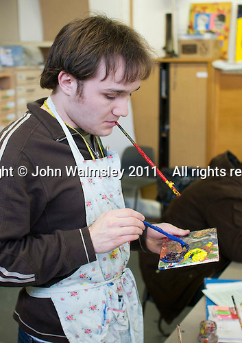 A student with autism mixing paints, Art & Design, Kingston College.