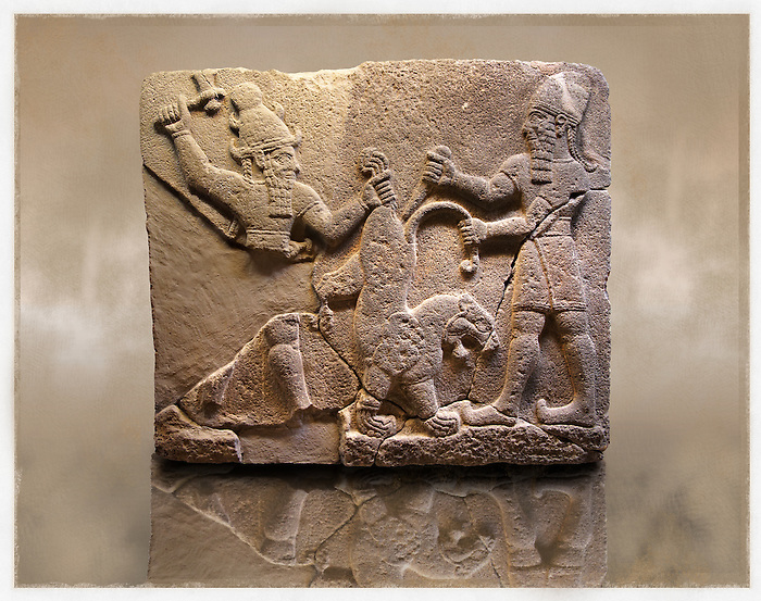 Picture & Image of  Neo-Hittite orthostat describing the legend of Gilgamesh from Karkamis,, Turkey. Museum of Anatolian Civilisations, Ankara. To the left a bearded deity with a horned helmet is holding a lions back leg and is about to strike it with an axe. To the right a man is stabbing the lion with a dagger. 4