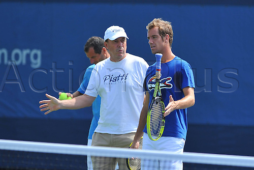 05.09.2013. New York, USA.   Richard Gasquet FRA and Ricardo Piatti discuss strokes at practise for the U.S. Open