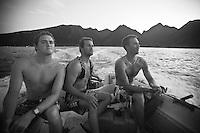 BEN DUNN (AUS), DAMIEN HOBGOOD (USA)  and DAVEY WEARE (ZAF) share a boat at Teahupoo, Tahiti, Thursday May 7 2009. Photo: joliphotos.com