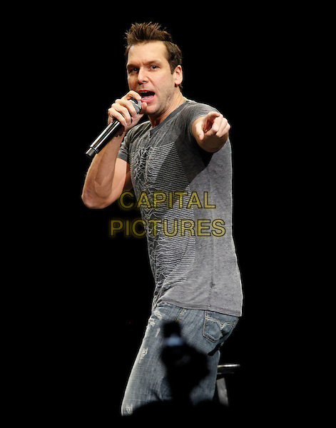 DANE COOK .performs live at the 1st Bank Center in Broomfield, on November 20th 2010..stand-up stand up show on stage half length grey gray t-shirt microphone hand speaking finger pointing .CAP/RKE/MM.©Michael Martin /RockinExposures/Capital Pictures.