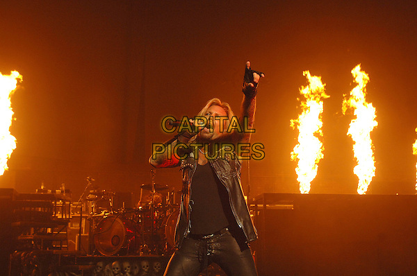 MOTLEY CRUE.performing live at the Carling Apollo, Hammersmith, London, England, 11th June 2007..half length live on stage gig concert band music hand arm up black gloves.CAP/ BEL.©Tom Belcher/Capital Pictures.