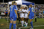 06 September 2013: Team captains meet before the game. North Carolina's Kealia Ohai (center, 7) and Crystal Dunn (19) and UCLA's Jenna Richmond (left, 7), Samantha Mewis (behind, left), and Sarah Killion (16). The University of North Carolina Tar Heels played the University of California Los Angeles Bruins at Koskinen Stadium in Durham, NC in a 2013 NCAA Division I Women's Soccer match. UNC won the game 1-0.