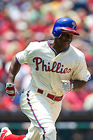 Philadelphia Phillies outfielder Juan Pierre #10 runs to first base during the Major League Baseball game against the Pittsburgh Pirates on June 28, 2012 at Citizens Bank Park in Philadelphia, Pennsylvania. The Pirates defeated the Phillies 5-4. (Andrew Woolley/Four Seam Images).