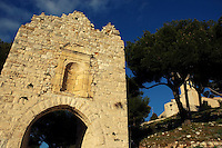 Old stone arch at Notre Dame du Chateau in Allauch Village, Provence, France.