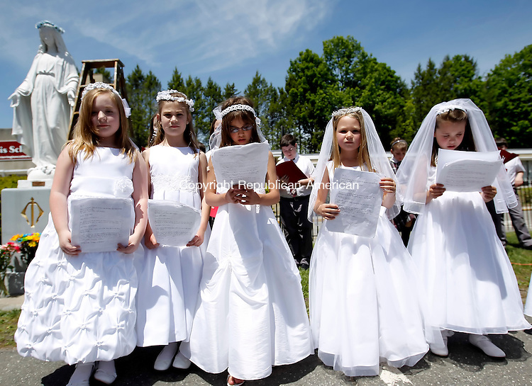 Torrington, CT-17, May 2010-051710CM05  Second graders from St. Peter St. Francis Catholic School in Torrington say closing prayers at the end of the ceremony Monday morning at the school in Torrington.  The class recently made their First Holy Communion, and were celebrating joined by other grades in the school.  The celebration which was led by Father John Lavorgna, of the Parish. --Christopher Massa Republican-American