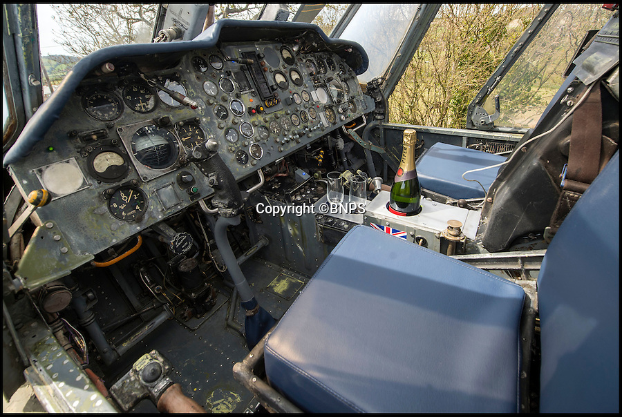 BNPS.co.uk (01202 558833)<br /> Pic: PhilYeomans/BNPS<br /> <br /> Sip Champagne whilst playing in the cockpit...<br /> <br /> Ultimate Heli-pad for a holiday - Campsite owner Stewart Dungey is hoping his new venture takes off - after turning a decommissioned Royal Navy helicopter into a unique holiday let.<br /> <br /> Stewart has spent £30,000 buying, transporting and converting a Cold War Westland Wessex chopper on his farm on the Isle of Wight<br /> <br /> With an Airstream caravan kitchen annex one side and a bedroom pod on the other the chopper now provides luxury accomodation for adventurous families.