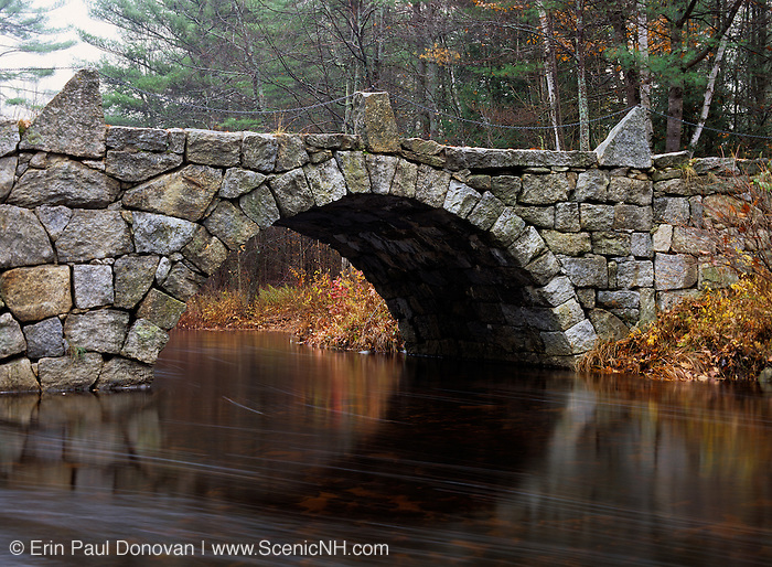 A stone double arched bridge which spans Beard Brook at the meeting of the Beard and Jones Road in Hillsborough, New Hampshire USA. Known as the Old Carr Bridge, built by Captain Jonathan Carr in 1840.
