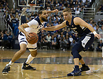 Nevada forward forward Caleb Martin (10) drives past Utah State guard Sam Merrill (5) in the first half of an NCAA college basketball game in Reno, Nev., Wednesday, Jan. 2, 2019. (AP Photo/Tom R. Smedes)