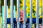 Here's Johnny: Frank McCarthy peeks through the iron railing to catch a view of the Legion v Kilcummin SFC game in Lewis Road  Killarney Saturday evening