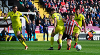 Lincoln City's Shay McCartan vies for possession with Cheltenham Town's Charlie Raglan<br /> <br /> Photographer Chris Vaughan/CameraSport<br /> <br /> The EFL Sky Bet League Two - Lincoln City v Cheltenham Town - Saturday 13th April 2019 - Sincil Bank - Lincoln<br /> <br /> World Copyright © 2019 CameraSport. All rights reserved. 43 Linden Ave. Countesthorpe. Leicester. England. LE8 5PG - Tel: +44 (0) 116 277 4147 - admin@camerasport.com - www.camerasport.com