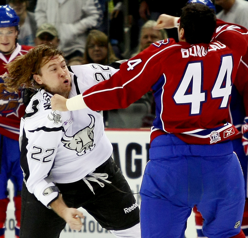 San Antonio Rampage's Eric Neilson, left, fights with Hamilton Bulldogs' Jimmy Bonneau during the first period of an AHL hockey game, Sunday, Dec. 19, 2010, at the AT&T Center in San Antonio. (Darren Abate/pressphotointl.com)