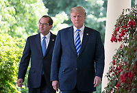 United States President Donald J. Trump and US Secretary of Health and Human Services Alex Azar walk on the Colonnade to the Rose Garden where the President will announce a &quot;new blueprint&quot; for lowering prescription drug prices in the Rose Garden of the White House in Washington, DC on Friday, May 11, 2018.<br /> CAP/MPI/RS<br /> &copy;RS/MPI/Capital Pictures