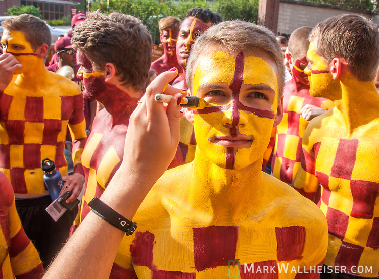 Florida State fan Kyle Hill, of the campus ministry group the FSU Checkerboys, has his face painted while he waits in line for an NCAA college football game between Florida State and Texas State in Tallahassee, Fla., Saturday, Sept. 05, 2015.   (AP Photo/Mark Wallheiser)