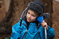 Joshua Doctorow, 4, plays telephone at Fiddleheads Forest School, a nature preschool located in the UW Botanic Gardens Washington Park Arboretum.