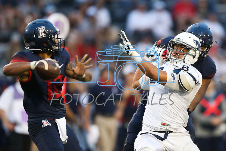 Nevada's Ian Seau (8) pressures Arizona's Anu Solomon (12) during the second half of an NCAA college football game in Reno, Nev., on Saturday, Sept. 12, 2015. Arizona won against Nevada 44-20. (AP Photo/Cathleen Allison)