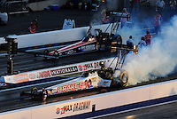 Apr. 13, 2012; Concord, NC, USA: NHRA top fuel dragster driver Doug Herbert (near) and Dom Lagana during qualifying for the Four Wide Nationals at zMax Dragway. Mandatory Credit: Mark J. Rebilas-