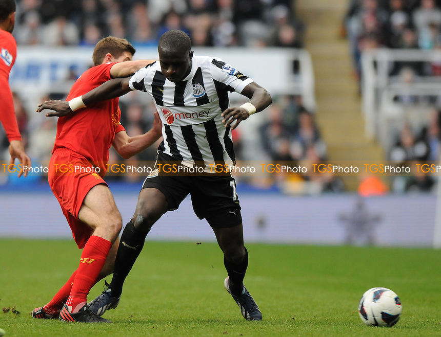 Liverpool captain Steven Gerrard battles with Moussa Sissoko of Newcastle United - Newcastle United vs Liverpool - Barclays Premier League Football at St James Park, Newcastle upon Tyne - 27/04/13 - MANDATORY CREDIT: Steven White/TGSPHOTO - Self billing applies where appropriate - 0845 094 6026 - contact@tgsphoto.co.uk - NO UNPAID USE