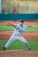 Ogden Raptors starting pitcher Jairo Pacheco (11) delivers a pitch to the plate against the Orem Owlz in Pioneer League action at Home of the Owlz on June 20, 2015 in Provo, Utah. The Raptors defeated the Owlz 9-6. (Stephen Smith/Four Seam Images)