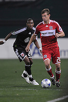 Chicago Fire forward Brian Mcbride (20) runs with the ball while chase by DC United midfielder Rodney Wallace (22), Chicago Fire tied  DC United 1-1 at  RFK Stadium, Saturday March 28, 2009.