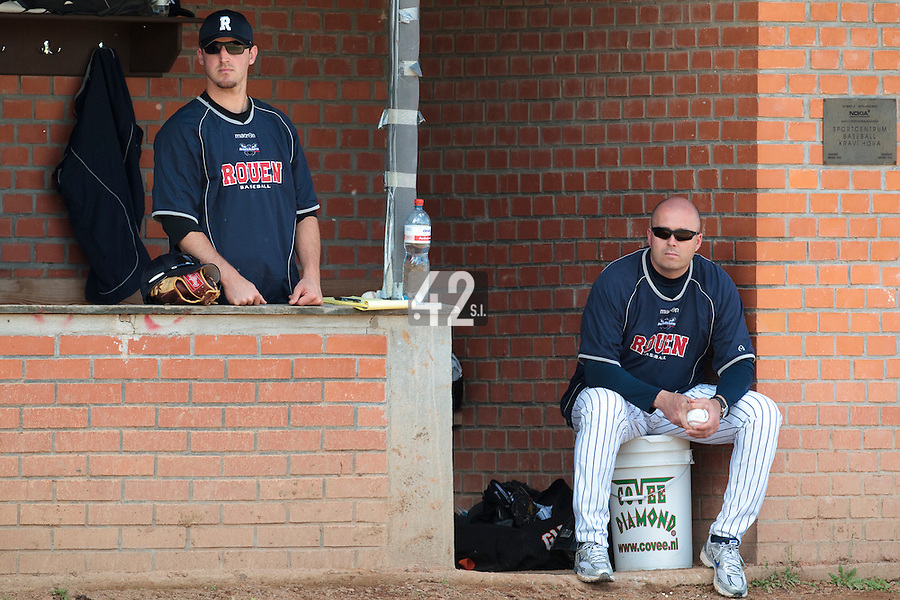 04 June 2010: Robin Roy of Rouen sits in the dugout next to Mike Musgrave during the 2010 Baseball European Cup match won 19-9 by Konica Minolta Pioniers over the Rouen Huskies, at the Kravi Hora ballpark, in Brno, Czech Republic.