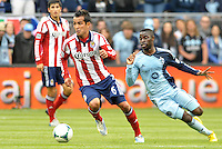 Jose Manuel Rivera (6) forward Chivas USA goes past Peterson Joseph (19) midfield Sporting KC..Sporting Kansas City defeated Chivas USA 4-0 at Sporting Park, Kansas City, Kansas.
