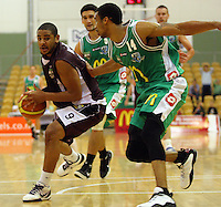 Heat guard Corey Webster braces to shoot at the edge of the key under pressure from Daryl Hudson during the NBL match between Manawatu Jets and Harbour Heat at Arena Manawatu, Palmerston North, New Zealand on Saturday 17 April 2010. Photo: Dave Lintott / lintottphoto.co.nz
