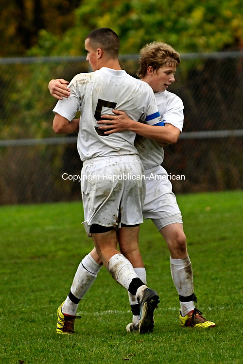 THOMASTON, CT - 09 October 2012-100912EC04--    Thomaston's Justin Taylor gives Drew Gagne a hug after Gagne scored a goal against Litchfield Tuesday.  The Bears won the home game, 1-0.  Erin Covey Republican-American.