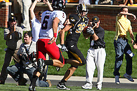 Tigers defensive end Stryker Sulak intercepts a pass from Texas Tech Red Raiders quarterback Graham Harrell and returns it 38-yards for a touchdown during the first quarter at Memorial Stadium in Columbia, Missouri on October 20, 2007. The Tigers won 41-10.