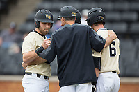 Wake Forest Demon Deacons head coach Tom Walter (16) gives instructions to Jake Mueller (6) and Logan Harvey (15) during the game against the Georgia Tech Yellow Jackets at David F. Couch Ballpark on March 26, 2017 in  Winston-Salem, North Carolina.  The Demon Deacons defeated the Yellow Jackets 8-4.  (Brian Westerholt/Four Seam Images)
