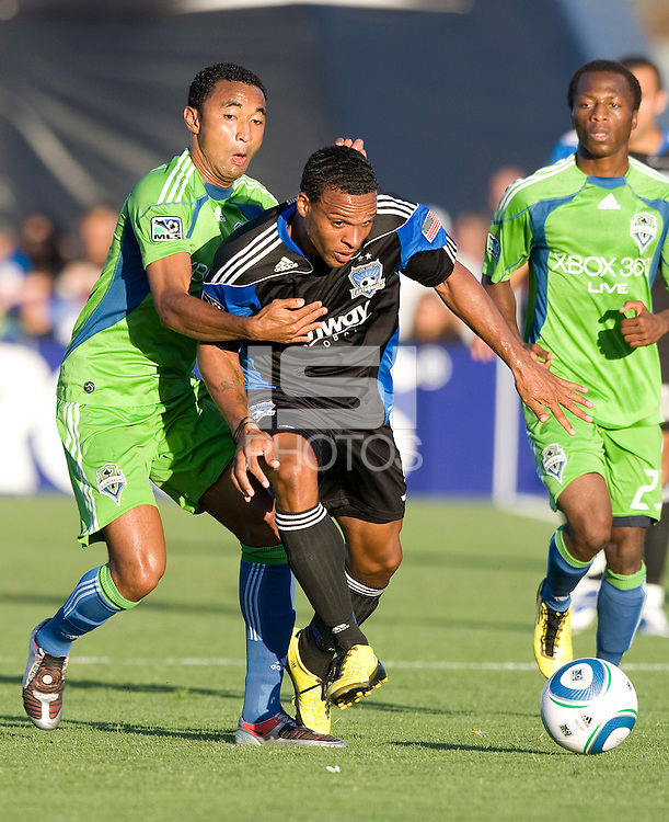 Scott Sealy of the Earthquakes dribbles the ball away from James Riley of Sounders during the game at Buck Shaw Stadium in Santa Clara, California on July 31st, 2010.   Seattle Sounders defeated San Jose Earthquakes, 1-0.