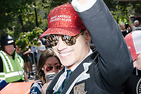 "Alt-right provocateur Milo Yiannopoulos arrives to serve as Grand Marshall of the Straight Pride Parade in Boston, Massachusetts, on Sat., August 31, 2019. Yiannopoulos wore a sequined red hat in the style of Make America Great Again (MAGA) hats reading ""Make America Straight Again."" Yiannopoulos addressed the crowd with a short speech on arrival and then rode the ""Trump Unity Bridge"" float for the duration of the parade. Despite leading the Straight Pride Parade and singing along with patriotic American songs throughout the parade, Yiannopoulos is gay and is not an American citizen."