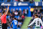 Takashi Inui of SD Eibar (R) gets a yellow card from Fifa Referee Alberola Rojas (L) during the La Liga 2017-18 match between Getafe CF and SD Eibar at Coliseum Alfonso Perez Stadium on 09 December 2017 in Getafe, Spain. Photo by Diego Souto / Power Sport Images