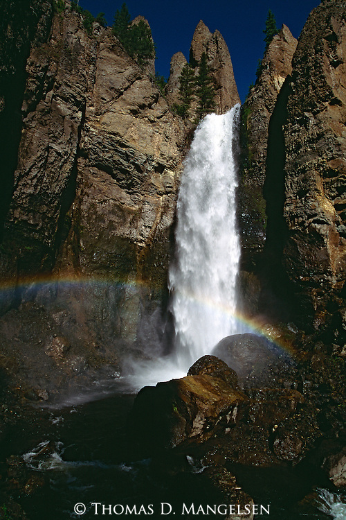 A rainbow stretches across the bottom of Tower Falls in Yellowstone National ParkA rainbow stretches across the bottom of Tower Falls in Yellowstone National Park, Wyoming.