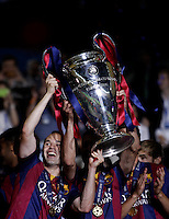 Calcio, finale di Champions League Juventus vs Barcellona all'Olympiastadion di Berlino, 6 giugno 2015.<br /> FC Barcelona's Andres Iniesta, left, and his teammates hold the trophy at the end of the Champions League football final between Juventus Turin and FC Barcelona, at Berlin's Olympiastadion, 6 June 2015. Barcelona won 3-1.<br /> UPDATE IMAGES PRESS/Isabella Bonotto