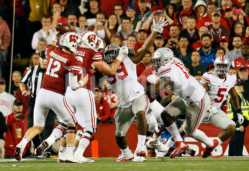 Ohio State Buckeyes defensive lineman Tyquan Lewis (59) pressures Wisconsin Badgers quarterback Alex Hornibrook (12) during overtime of the NCAA football game at Camp Randall Stadium in Madison, Wisconsin on Oct. 15, 2016. Ohio State won 30-23. (Adam Cairns / The Columbus Dispatch)