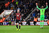 Ryan Fraser of AFC Bournemouth left celebrates scoring the second goal as Huddersfield Town keeper Jonas Lossl  appeals for offside during AFC Bournemouth vs Huddersfield Town, Premier League Football at the Vitality Stadium on 4th December 2018