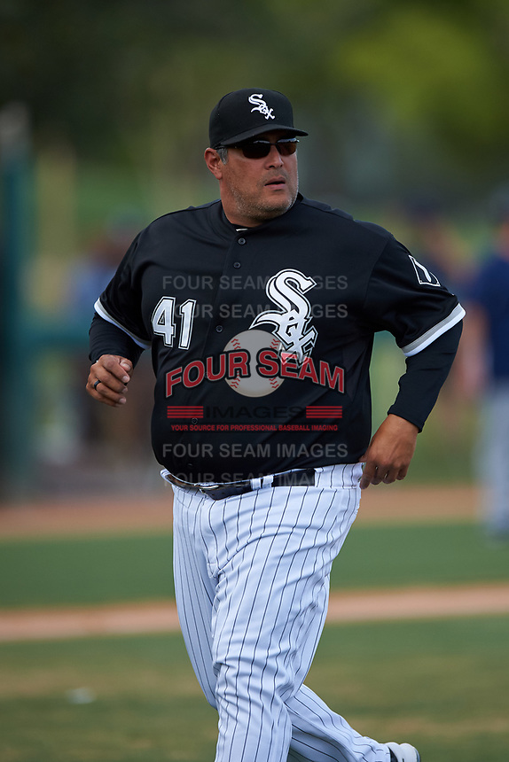 AZL White Sox pitching coach Felipe Lira (41) walks off the field after a visit to the mound during an Arizona League game against the AZL Padres 2 on June 29, 2019 at Camelback Ranch in Glendale, Arizona. The AZL Padres 2 defeated the AZL White Sox 7-3. (Zachary Lucy/Four Seam Images)