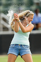 A young fan participates in the water balloon toss game between innings of the South Atlantic League game between the Greensboro Grasshoppers and the Kannapolis Intimidators at CMC-Northeast Stadium on July 13, 2013 in Kannapolis, North Carolina.  The Intimidators defeated the Grasshoppers 7-5.   (Brian Westerholt/Four Seam Images)