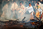Buddhist monks wooden prayers in the ceremonial bonfire during the Fire-walking Festival (Hiwatari-sai) at Mt. Takao on Sunday, March 12, 2017 in Hachioji, Japan.<br /> Photo by Kevin Clifford