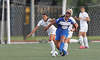 Boston Breakers midfielder Mariah Noguiera (20) passes the ball as Western New York Flash forward Western New York Flash forward Samantha Kerr (4) defends. In a National Women's Soccer League Elite (NWSL) match, the Boston Breakers (blue) tied Western New York Flash (white), 2-2, at Dilboy Stadium on June 5, 2013.
