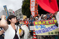 Protest against the revision of article 9 of the Japanese Constitution outside the Prime-Minister's house in Kasumigasaki, Tokyo, Japan. Monday June 30th 2014. Over 10,000 people showed their support for Japan's unique peace constitution and called on the government to halt its reinterpretation of Article 9 allowing Collect Self Defence which is expected to become law on July 1st