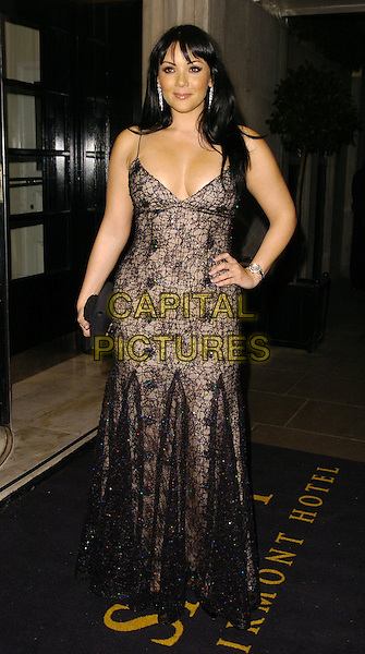 MARTINE McCUTCHEON.Attends The Simone Cowland Trust Gala Fundraiser .at The Savoy, London, England, October 21st 2006..full length sparkly brown black lace dress clutch bag fringe hand on hip watch.Ref: CAN.www.capitalpictures.com.sales@capitalpictures.com.©Can Nguyen/Capital Pictures