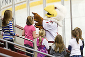 """Baldwin """"chats"""" with some young fans. - The Boston College Eagles defeated the visiting Northeastern University Huskies 2-1 on Sunday, January 30, 2011, at Conte Forum in Chestnut Hill, Massachusetts."""